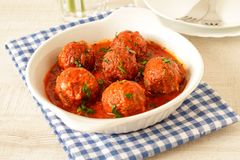 Meatballs with spicy tomato sauce on a plate. Homemade italian meatballs with spicy tomato sauce on a plate Stock Image