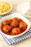 Meatballs with spicy tomato sauce on a plate. And spaghetti Stock Photography