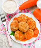 Meatballs steamed from dietary meat with carrots and rice Stock Photo