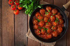 Meatballs. In sweet and sour tomato sauce stock photos