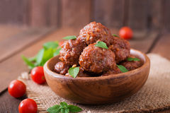 Meatballs in sweet and sour tomato sauce and basil Stock Photography
