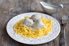 Meatballs with tagliatelli and white sauce Royalty Free Stock Photography
