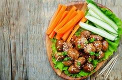 Meatballs with Teriyaki sauce and sesame seeds Stock Photography