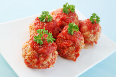 Meatballs in tomato sauce. Noisettes are stewed in the tomato sauce Royalty Free Stock Images