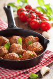 Meatballs with tomato sauce in black pan Stock Images