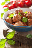 Meatballs with tomato sauce in blue bowl Royalty Free Stock Image