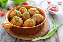 Meatballs with tomato sauce and chive Royalty Free Stock Images