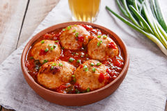Meatballs with tomato sauce in a clay bowl stock images
