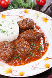 Meatballs with tomato sauce and cooked rice Royalty Free Stock Images