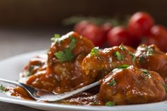 Meatballs with tomato sauce and fresh chopped parsley on plate Stock Photography