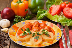 Meatballs in tomato sauce. With fresh salad Stock Photography