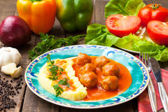 Meatballs in tomato sauce. With fresh salad and parsley Royalty Free Stock Photos