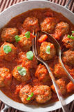 Meatballs with tomato sauce in pan with spoon Royalty Free Stock Photography