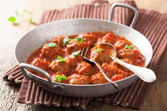 Meatballs with tomato sauce in pan with spoon Royalty Free Stock Photo
