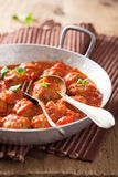 Meatballs with tomato sauce in pan with spoon Stock Photos