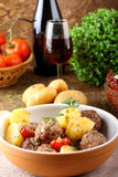 Meatballs with tomato sauce with potatoes in broth Stock Photo
