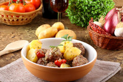 Meatballs with tomato sauce with potatoes in broth Royalty Free Stock Image