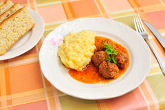 Meatballs in tomato sauce and puree Stock Image