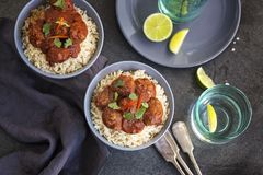 Meatballs in tomato sauce served on rice. Two bowls of classic Meatballs in tomato sauce served on rice royalty free stock photo