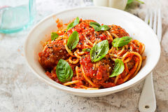 Meatballs in tomato sauce with spaghetti. And basil Stock Photos