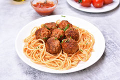 Meatballs in tomato sauce and spaghetti Stock Images