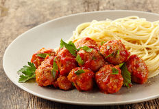 Meatballs with tomato sauce and spaghetti Stock Image