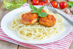 Meatballs in tomato sauce with spaghetti on a white plate Royalty Free Stock Images