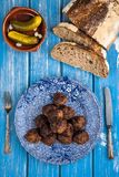 Meatballs. Traditional meat balls served with bread and pickles stock photo