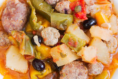 Meatballs and vegetables. Meatballs stewed with potatoes, olives, tomato, peppers and capers Royalty Free Stock Images