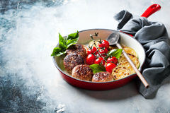 Meatballs with vegetables in a cast iron skillet royalty free stock photos