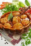 Meatballs with vegetables and tomato sauce stock images