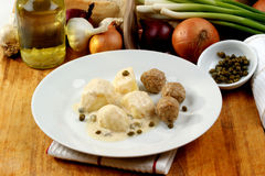 Meatballs in a white sauce with capers Royalty Free Stock Image