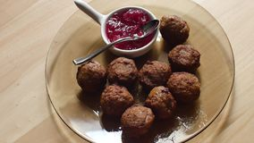 Meatballs on a wooden background stock video footage