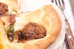 Meatballs  and yorkshire pudding Stock Images