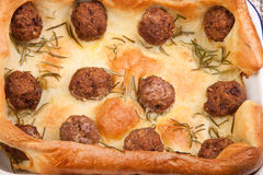 Meatballs in yorkshire pudding Stock Images