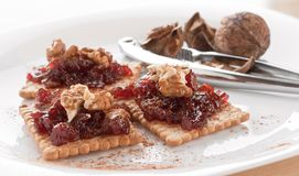Meatless Food Cracker with Jam and Walnuts Royalty Free Stock Photos