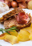 Meatloaf and baked potatoes Stock Photography