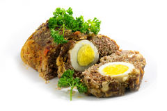 Meatloaf with boiled eggs inside for Easter, isolated Stock Photos