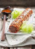 Meatloaf with cheese wrapped in bacon. bacon sushi Royalty Free Stock Photo