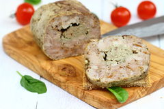 Meatloaf. Cut at the dinner table stock photos