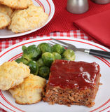 Meatloaf Dinner. With brussels sprouts and biscuits Royalty Free Stock Photos