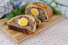 Meatloaf with egg and greens in the test Stock Image