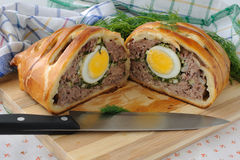 Meatloaf with egg and greens in the test Stock Images