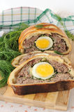 Meatloaf with egg and greens in the test Stock Photos