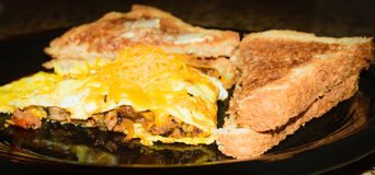 Meatloaf,egg omelette with honey wheat toast and real butter Stock Images