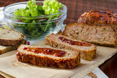 Meatloaf. Homemade traditional meatloaf with ketchup, bread and salad Stock Image