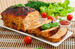 Meatloaf with ketchup and basil. Homemade ground meatloaf with ketchup and basil Royalty Free Stock Photography