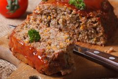 Meatloaf with ketchup close-up on chopping board Royalty Free Stock Photography