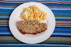 Meatloaf and Macaroni Cheese on Striped Placemat Royalty Free Stock Image