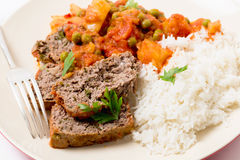 Meatloaf meal with rice and fork Stock Photo